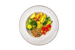 Buddha Βowl with quinoa, baby potatoes, broccoli, cherry tomatoes, cucumber, avocado cream,lime zest, seaseme seeds with lemon-oil sauce