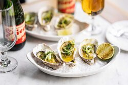 Grilled oysters with curry butter