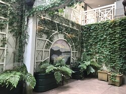 The Hawkins Brown Room Walled Garden with al fresco paintings by Chip Holton artist-in-residence.