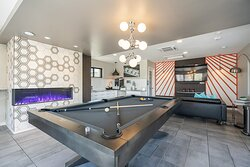 Upgraded Clubhouse with pool table, fireplace, HD TV, complimentary premium coffee, seating, and a neon-lit patio that faces S. Virginia St.