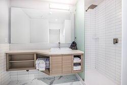Standard bathrooms feature a walk-in shower