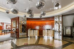 The spacious oval Hotel Lobby oozes elegance with metal and high gloss wood finishes throughout