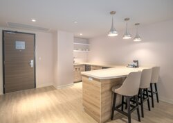 Kitchenette in our Executive Suites; includes bar fridge, microwave and dishwasher