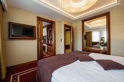 The Royal Suite Guest Bedroom is conveniently located out from the living room area