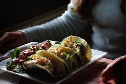 Hawaiian fish tacos Haddock, pineapple and jalapeno salsa, aioli, mixed greens, and pickled red onion in flour tortillas.