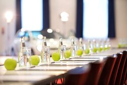 Conference Centre Apples and Water On Tables