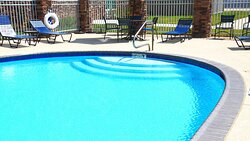 Take a swim outdoors after using our FREE Fitness Center