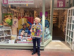 Jane Horrocks outside The Brighton Box Gallery holding Fat Pigeon Art's Absolutely Fabulous art piece