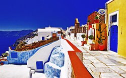 Most of us have seen pictures of Santorini/Thira as the island often has been used in the world promotion of Greece as a tourist attraction. The blue and white colours are the characteristic of this volcano island which scientists often relate to the mythical island of Atlantis.