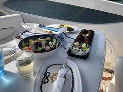 Lunch of amazing greek salad, meatballs, tzatziki, crostini & tapenade, stuffed grape leaves, and more.