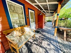 Wrap Around Porch with plenty of seating for Guests