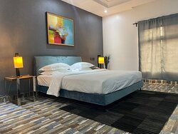 Our Modern MUSE Deluxe Suite featuring a King Size Bed
