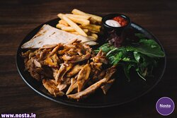 Tavuk Doner (Gyros)   Chicken doner , served with house bread, salad, sauce and chips or rice. 1