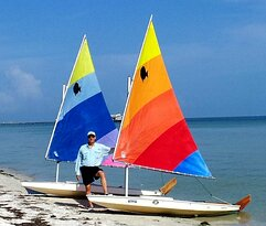 Captain/Coach Jay with two Sunfish Sailboats