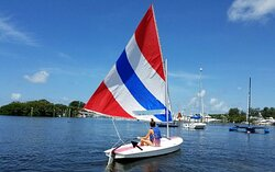 A young student sailing on a Sunfish Sailboat