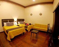 Habitación 2, 2 Camas Matrimoniales, 1 Sofá Cama, Smart Tv con contenidos digitales, fibra óptica, aire acondicionado, ventilador, piso de madera y mucho más.