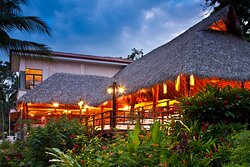 """Breakfast and dinner are served at the """"Cristobal"""" Restaurant, overlooking the ocean with a casual yet romantic setting. This nice restaurant is decorated with bamboo and furnished with fine Cristobal wood."""