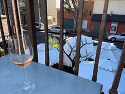 Complimentary glass of Rose offered at check in; this is view from patio overlooking the outdoor dining area of the Granada Bistro in the front of the hotel.