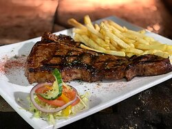 T-bone served with chips