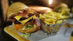 Scrumptious Double bacon and cheese burgers served with chips.