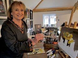 Artist Carol Davison at work in her gallery.