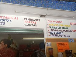 Mexican dishes clearly listed on wall