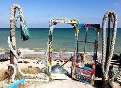 """The wooden door next to Cherhana (""""gate"""" to the nudist beach)."""