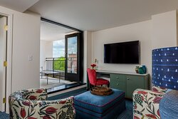The Bradley King Balcony Suite. Offering 522 square-feet of space, a living room with a pull-out sofa, a walk-in shower and city views, our Balcony King Suite will make you feel right at home.