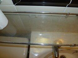 Dirty glass shelf. No plug in basin. Bath plug (loose) didn't fit.