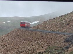 passing train coming down the mountain