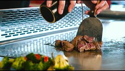 Teppanyaki steak cooked with special sauce