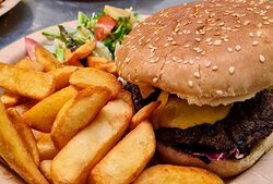 Truly scrumptious - Ultimate steak burger with bacon, cheese & salad, served with chips and salad.