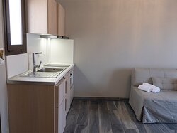 Apartment room with a fully equipped kitchen