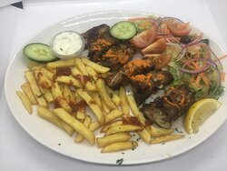ENTRECOSTO GRELHADO grilled pork ribs served with chips and salad.