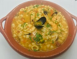 FEIJOADA DE MARISCOS seafood beans stew served with rice.