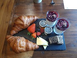Continental breakfast provided to each table - lovely croissants and fruit compote in particular.