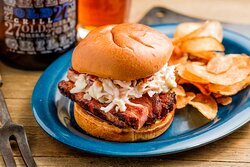 Award winning Pork Belly Sandwich rated Top Ten Sandwiches to Eat in America by Restaurant Hospitality Magazine.