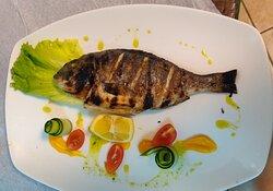 Orata fish on the grill.
