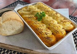 Lamb shepherd's pie   Slow cooked lamb shepherd's pie topped with mashed potatoes served with warmed baguette  Available for 299 baht