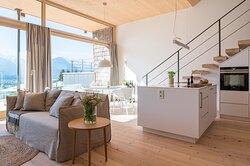 Wohnzimmer mit offener Küche Ferienwohnung Hirschsprung
