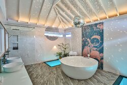 Separate rainfall shower and disco oversized soaking bathtub available in all villas
