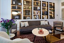 Guest lounge on the ground floor at Lexham Gardens by Cheval Maison