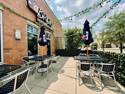 Our patio is the perfect place to sit with a fresh pizza, cold beverage, and friends.