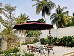 Family play ground or meal area. You can relax and enjoy meal here anytime you wish. In day time view of our backyard area face to sea.
