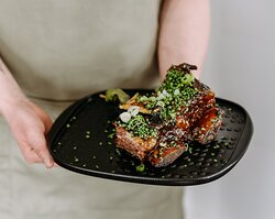 Our house signature dish beef  ribs with our secret barbeque sauce and apple glaze.