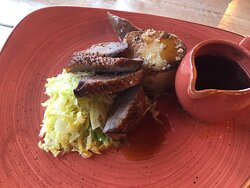 Pan roasted duck breast with fondant potatoes, cabbage and jus.