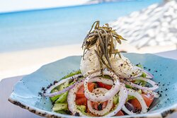 Traditional Greek salad with ksinomizithra (Sifnos local white cheese) and kritamo