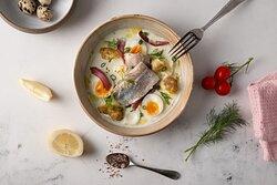 Śledź w wódce bursztynowej/ Marinated herring with amber vodka