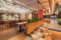 Welcome to our kitchen! Grab a tray and walk along the line to order your food and experience the lively udon kitchen