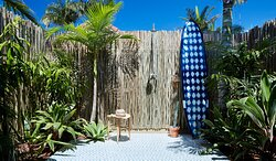 Albatross Rooms each have a private courtyard and outdoor shower